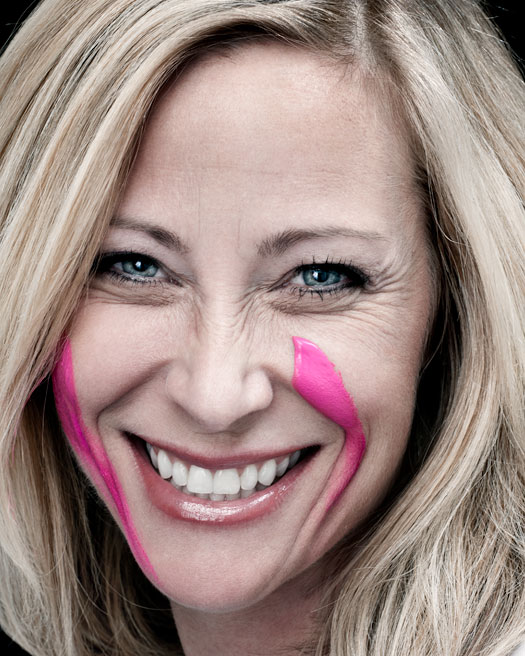 Kim stock with pink paint on her face