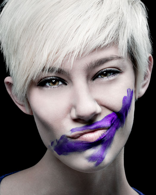 Marie Vaccarello with purple paint on her face